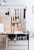 Workbench with tools hung on wooden plate