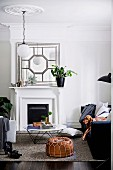 Traditional living room with fireplace and stucco rosette, dog on couch