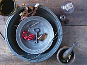 Herbalist arrangement of pestle and mortar, apothecary bottle and key in pewter dish