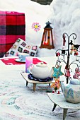 Teapots on set and decorated table outside in wintry atmosphere