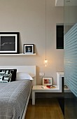 Modern bedside table element under pendant lamp