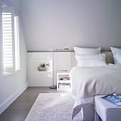 Bright, classic, attic bedroom