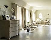Elegant, beige living room with pairs of furnishings