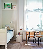 Desk below window in child's bedroom
