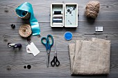 Sewing utensils and accessories on grey table
