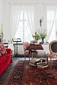 Persian rug in artistic interior in shades of red