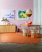 Partially laid terracotta floor in the dining room with a pink wall