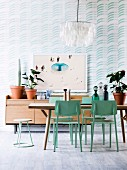 Dining room in soft shades of blue with wooden furniture and pattern wallpaper
