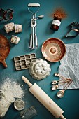Vintage baking and kitchen utensils on a petrol colored surface