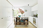 Mobile kitchen island with shelves in white kitchen