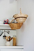 Baskets hung above kitchen counter