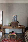 Rustic wooden table, trunk, artistic altar cabinet and gilt side table
