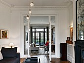 Eclectic, elegant living room in period apartment with stucco ceiling