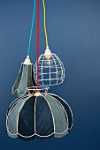 Wire lampshades lined with various shades of denim