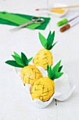 Pineapple ornaments made from blown eggs