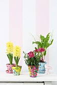 Spring flowers in terracotta pots covered in colourful fabrics