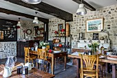 Old wooden furniture and stone wall in breakfast room