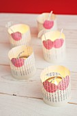Romantic tealight holders made from old book pages and painted with cherry motifs