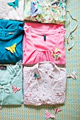 Butterfly motifs folded from origami paper with various patterns on ladies' clothing