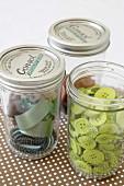 Sewing materials stored in screwtop jars