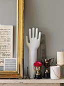Gilt frame, vintage silver trophy, hand ornament and miniature Eiffel tower on marble mantelpiece
