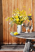 Yellow Easter arrangement of forsythia, narcissus and Easter eggs