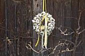 Easter wreath made from egg boxes and colourful ribbons