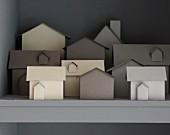 Paper models of houses on shelf