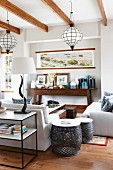 Console table, metal side tables and sofas in rustic lounge area