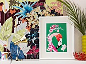 Graphic flamingo print in front of floral fabric panel