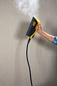 Removing wallpaper using a steamer