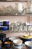 Crockery on open metal shelves in kitchen