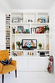 TV on white open-fronted shelves