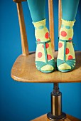 Socks decorated with colourful spots of paint