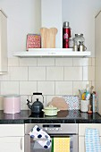 Retro kitchen utensils on kitchen counter with granite worksurface