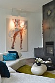 Fireplace, metal chimney breast and modern artwork in lounge area