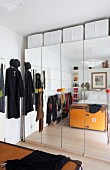 Mirrored wardrobes and storage solutions in small bedroom