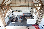 View down into living area with light-bulb pendant lamps in converted barn
