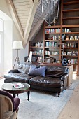 Leather sofa and bookcase in attic lounge area