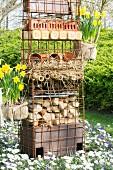 DIY bug hotel in flowerbed