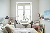Cosy, feminine bedroom in shades of grey