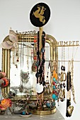 Costume jewellery hung on jewellery stand in front of mirror