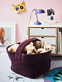 A homemade crocheted floor basket made from felting wool