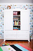 Wardrobe with bookcase module in child's bedroom