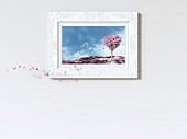 Leaves falling from heart-shaped tree in picture frame, 3D rendering