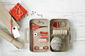 Craft supplies in a small cardboard suitcase
