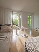 Modern living room with view through open terrace door