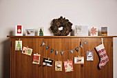 Christmas cards hung on wooden sideboard