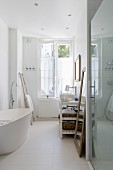 White, free-standing bathtub in bathroom