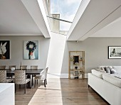Light shining through skylight into open-plan interior